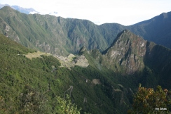 View of Machu Picchu from the trail leading to the Sun Gate. The switchback road used by buses to transport tourists to the site is seen at the bottom.