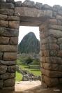 A trapezoidal Incan door frames the Huaya Picchu peak.