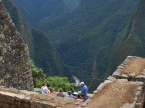 A guide teaching a group at Machu Picchu.