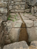 One of the many intriguing water channels--a well-planned feature of Machu Picchu.