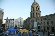 Plaza San Francisco--full of people, loud music, and mobile companies hawking goods.