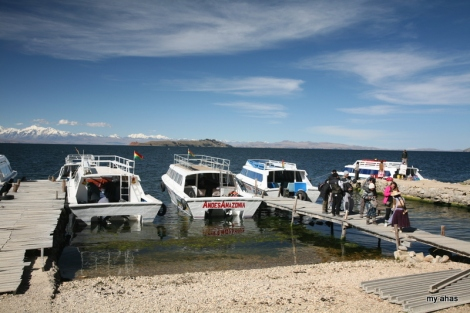 Locals collect a small admission fee as tourists arrive at Isla del Sol