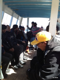 Our guide (in the yellow cap) during the ferry crossing.