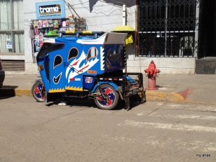 A mototaxi; we started seeing these as soon as we crossed the border into Peru, but they're only allowed in smaller cities.
